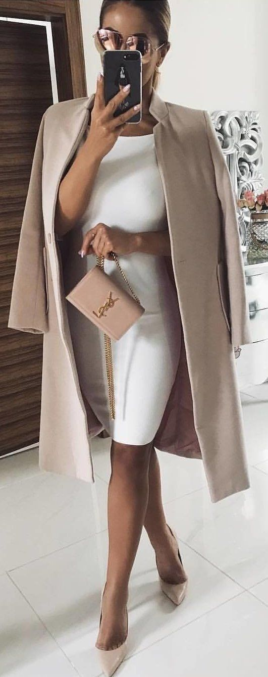 Elegant beige Cote with a white dress belted with a Tawny thick belt. Accessoriz…