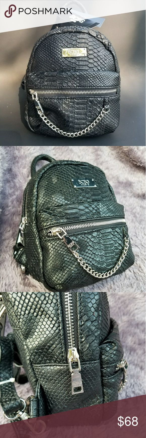 BCBG mini backpack 🎒 BCBG faux snake skin mini backpack 🛍 🎒NEW!! With tags 🎒Originally $125  🎒Adjustable straps 🎒black BCBG Bags
