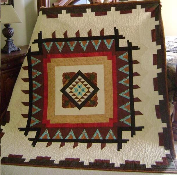 This is the quilt I made for Al's brother Joe. He lets us stay in his home down here in Apache Junction, Arizona. I really think he's go...