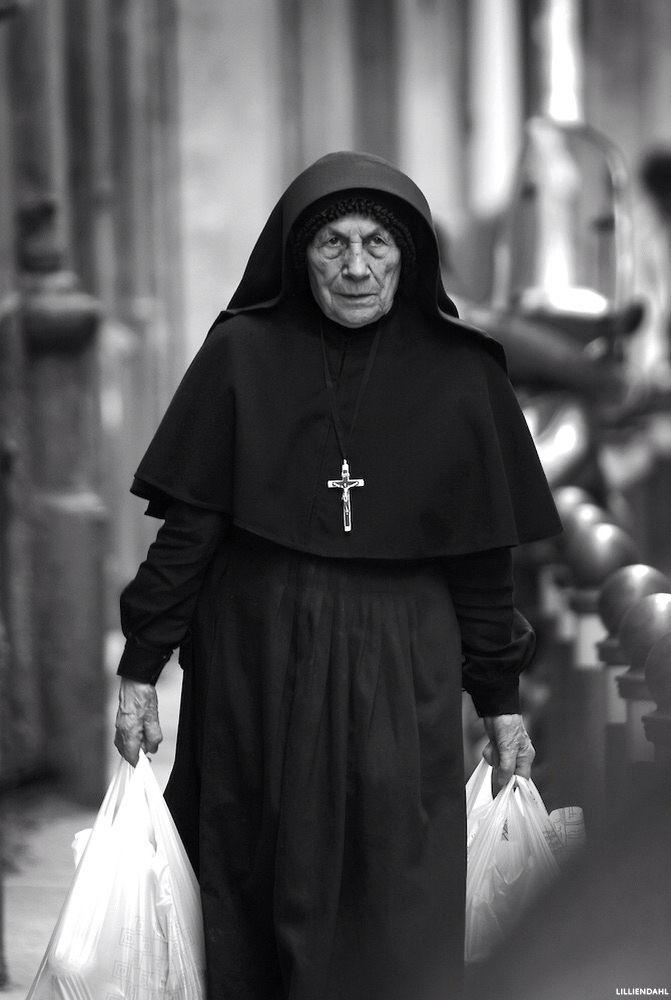 Shopping nun in Bologna, Italy by Karl R Lilliendahl