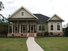 acadian style homes - Is this the kind of gable he meant for the porch? I like this except symmetrical of course and not that wing!