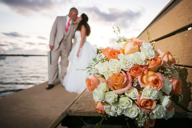 Picturesque Palmetto Wedding at Palmetto Riverside Bed and Breakfast, FL  Beautiful coral and white rose bouquet!  Limelight Photography