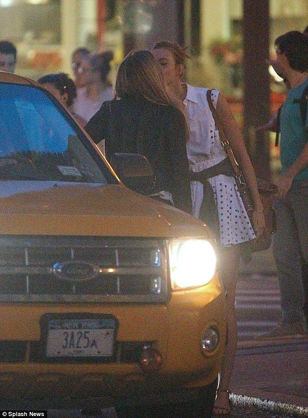 Cara Delevingne and Karlie Kloss exchanged a goodbye kiss on the lips before slipping into a cab http://dailym.ai/1jijGGw