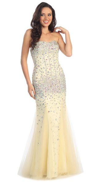 A gorgeous fit and flare mermaid gown with diamond gems and tulle material that covers bottom of dress
