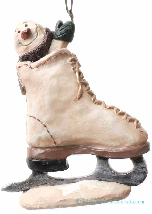 Cute Resin Ornament Snowman in Skate  Size: 4 inches tall and 3.5 inches wide. Great gifts for skaters.