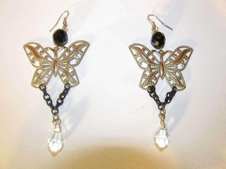 Handmade earrings (1 pair)  Made with metal butterflies, chains, crystals, glass beads and antiallergic hangings.