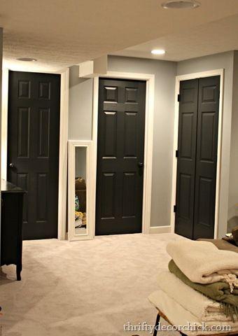 Black interior doors,  white trim through out house,  grey walls, white trim hall bathroom