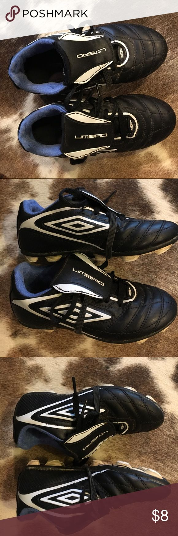 Umbro kids soccer shoes. Unisex Good used condition,these have been washed so soles will be as pictured. One scuff mark on toe of left shoe. They also have straps to hold shoelaces down. Umbro Shoes Sneakers