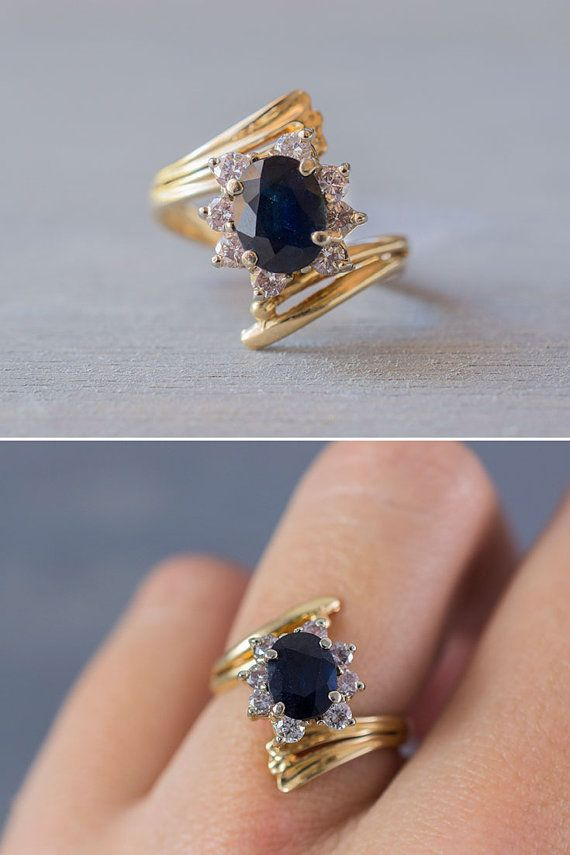A 1980's vintage 14k yellow gold, oval cut blue sapphire and diamond engagement ring, presented by MintAndMade.