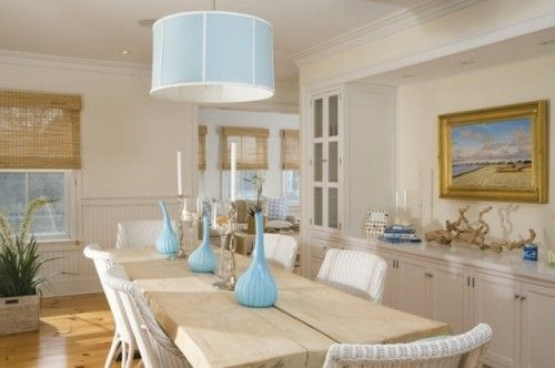 I adore this beachy dining room. It's captured that coastal vibe without going over the top. The blue accents, sand-colored table, rattan chairs and driftwood sculpture create a soothing oceanside tableau. And there's nary a flip-flop or sand dollar in sight.  by Workshop/apd
