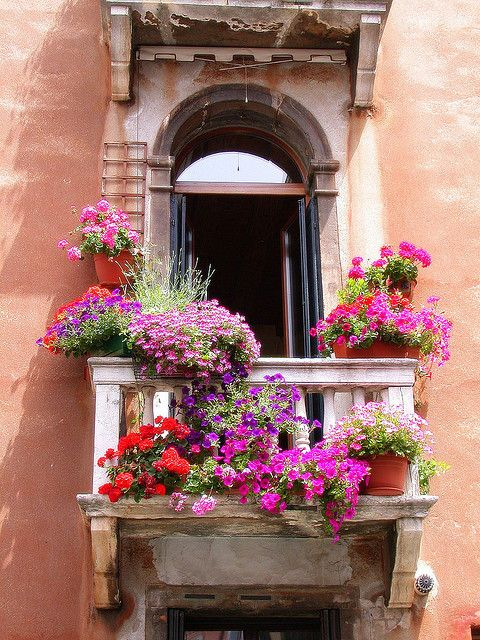 Colorful balcony in Venice, Italy  Note:  A pair of these would look nice over the front entry area