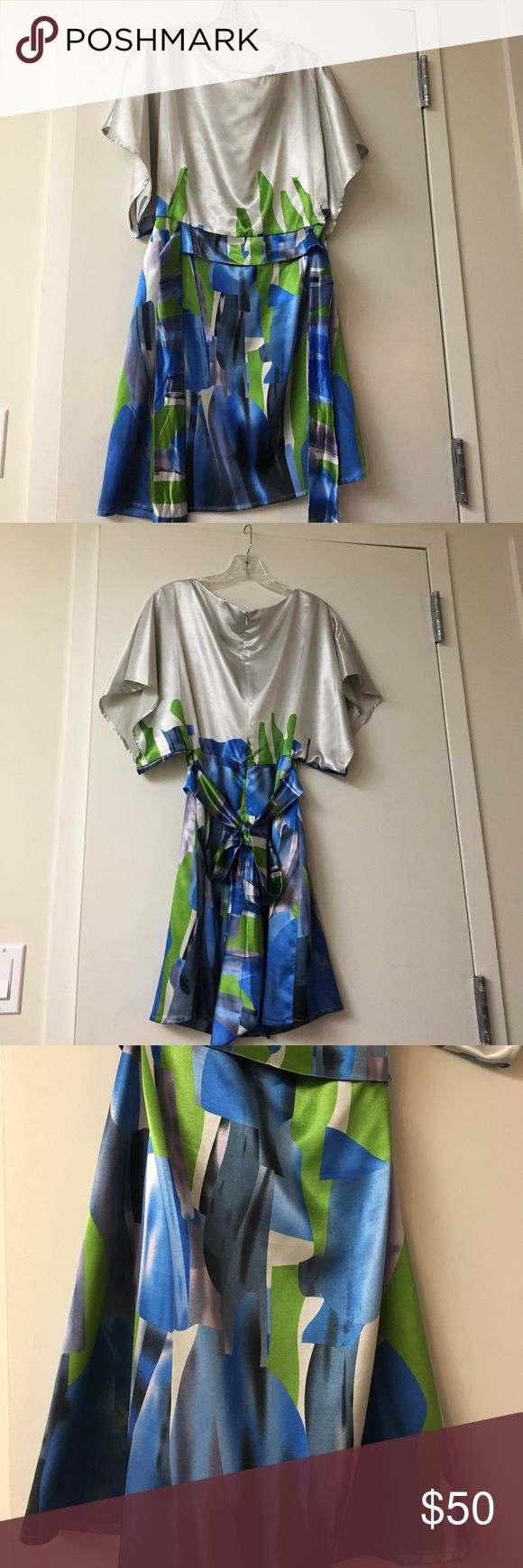 BCBG MAXAZARIA Summer Dress in XS Flowy Summer Dress in Silver with a blue and green block pattern. Attached tie creates a nice waist line. Only worn once to a wedding! Perfect for summer events or a night out! BCBGMaxAzria Dresses Mini