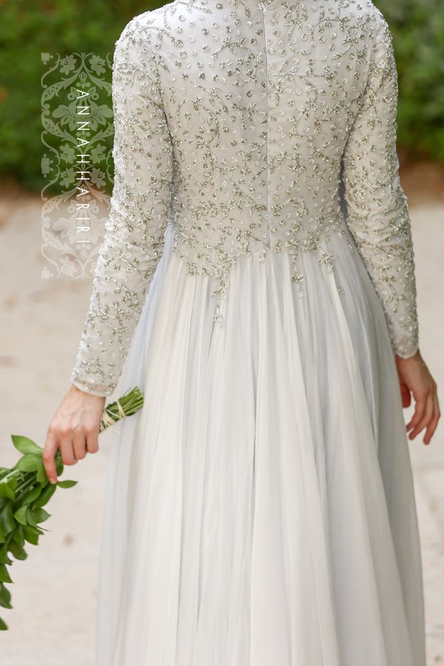 Sheath silhouette, court train, high neckline, and long sleeves.