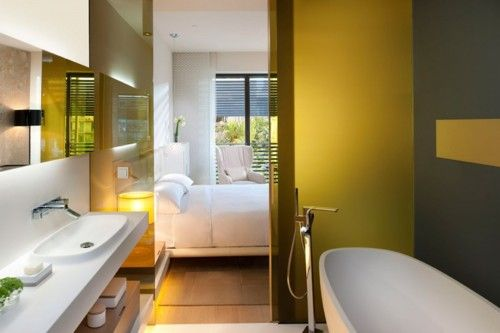 Yellow! What a great/bold choice for the bathroom. Especially one that is right off an all white bedroom! What a nice surprise.