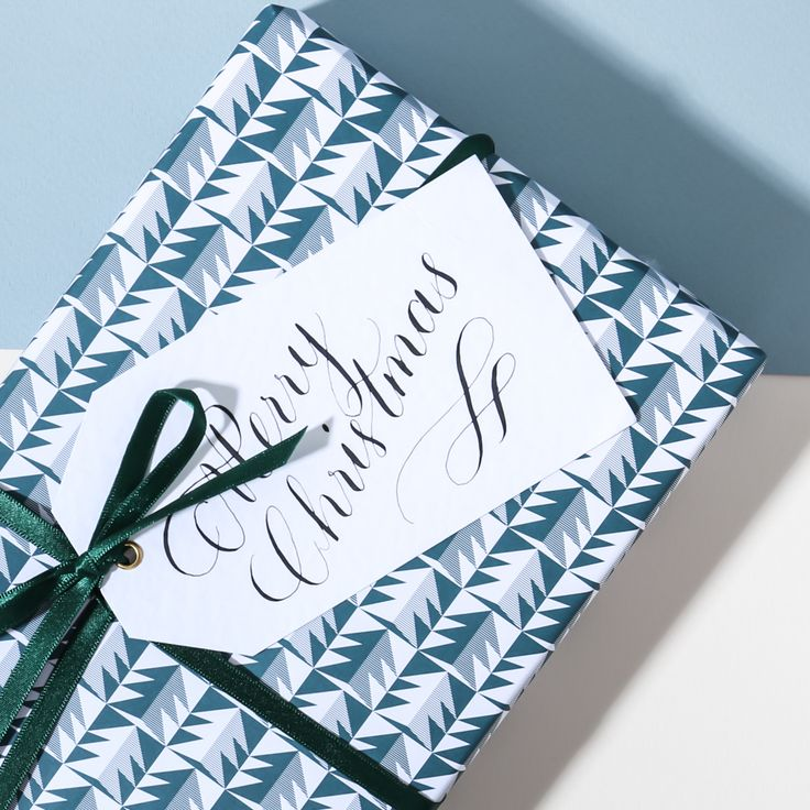 A round-up of beautifully designed Christmas wrapping paper / gift wrap to make your presents look stunning under the tree this year.