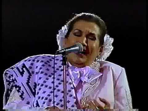"""▶ Lola Beltrán en Bellas Artes -HUAPANGO TORERO- ,199o. María Lucila Beltrán Ruiz (1932–1996), more commonly known as Lola Beltrán, was a Mexican recording artist, actress, and television presenter. Renowned for her interpretation of the songs """"Cucurrucucú paloma"""" and """"Paloma negra"""". From 1976 to 1984 she also hosted the musical shows Noches Tapatías and El Estudio de Lola Beltrán respectively. She died of a massive pulmonary embolism in Mexico City."""