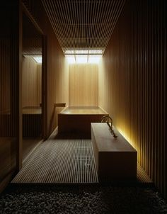 Sauna - beautiful lighting. Saunas can be so dark but these lights highlight the structure of the room so well.