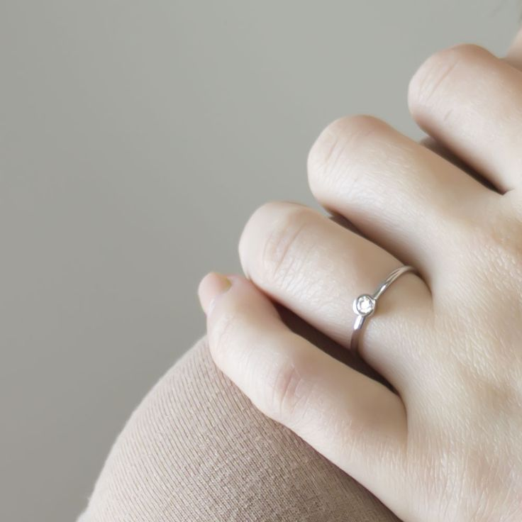 Elsa Storm - Little Star Ring Silver Remember that there's always a little light in the darkness. Our little star ring is a tiny solitaire ring with a simple and subtle design. Featuring a thin rounded band with a small clear cubic zirconia. We think this minimalist piece looks beautiful on its own and adds a touch of discreet elegance by day or night.