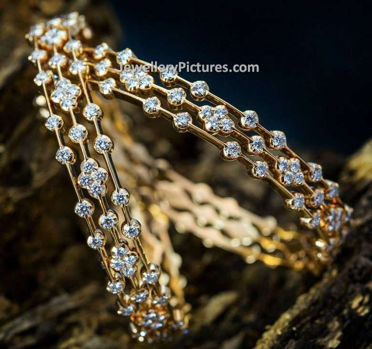 Designer Broad Sparkling Diamond Bangles Designs with latest carvings.Three layered model single bangle but seems as if they are different ones.
