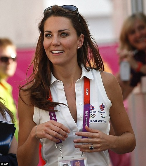 Kate can even make athletic gear and a huge nametag look amazing.