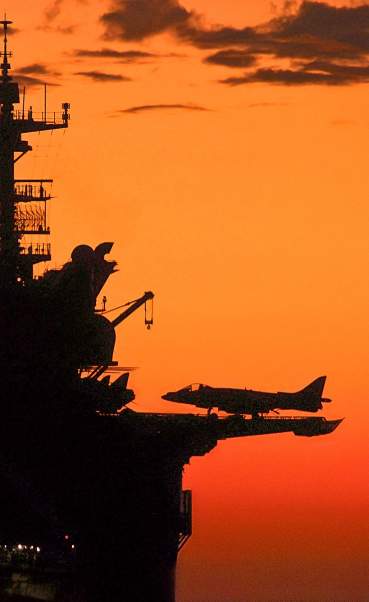 Aircraft carriers are amazing...even more amazing against the backdrop of the sunset.