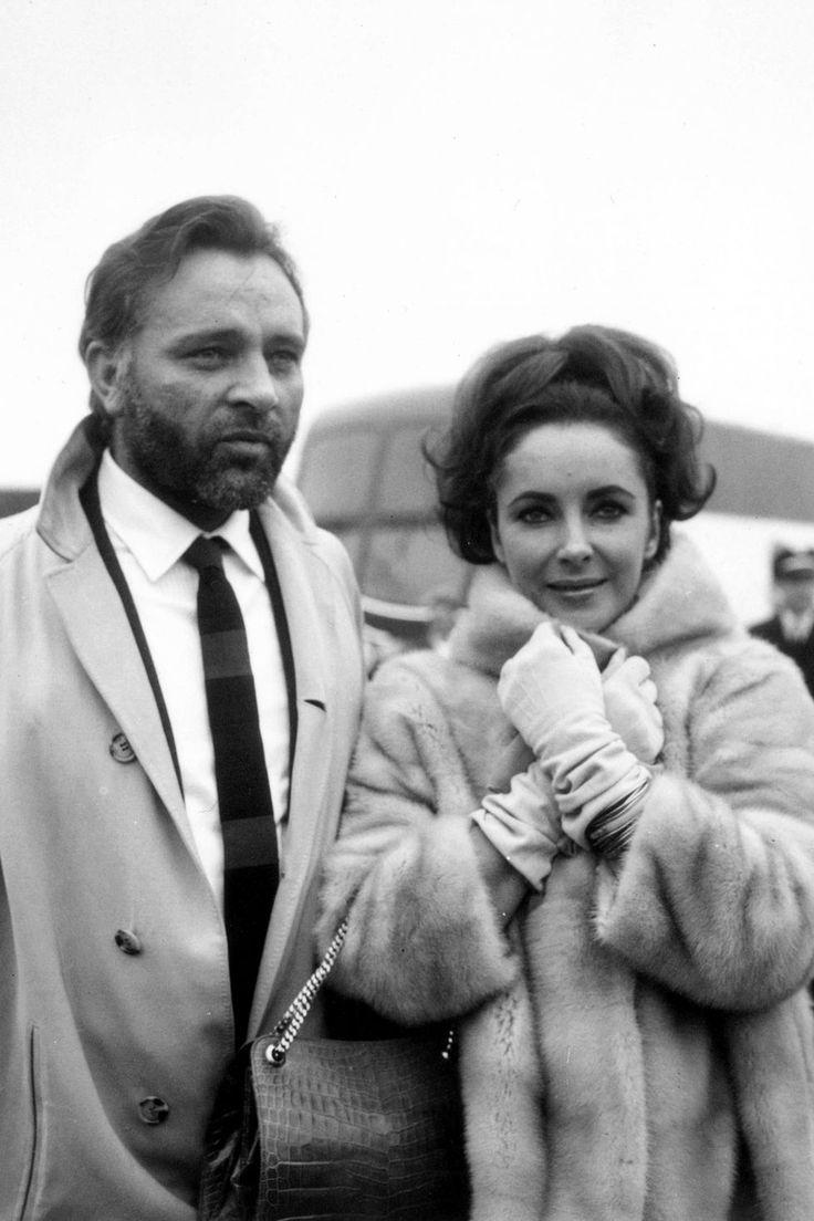 1st February 1966: Welsh stage and film actor Richard Burton (1925 - 1984) with his wife, actress Elizabeth Taylor at London Airport. (Photo by George Stroud/Express/Getty Images)