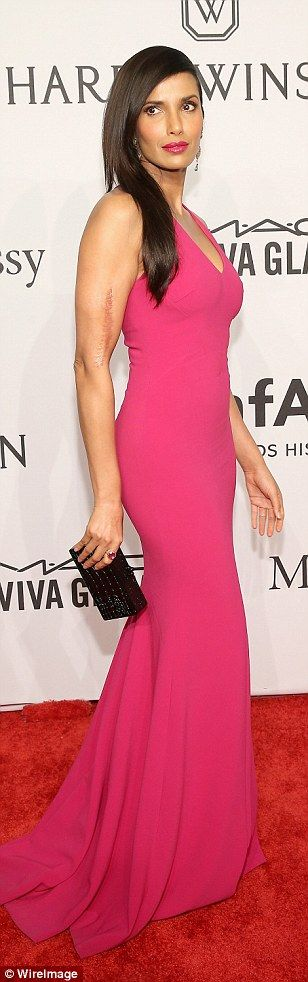 Pretty in pink: Padma Lakshmi showed off her curvaceous figure in a hot pink number...