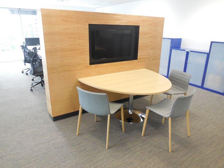 Project team work area with integrated Media. Panel look timber veneer