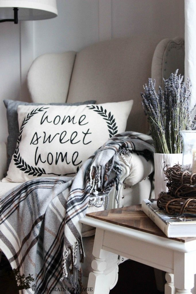 Lovely neutral black and white rustic vintage decor. Love the tartan plaid blanket & Home Sweet Home Pillow.