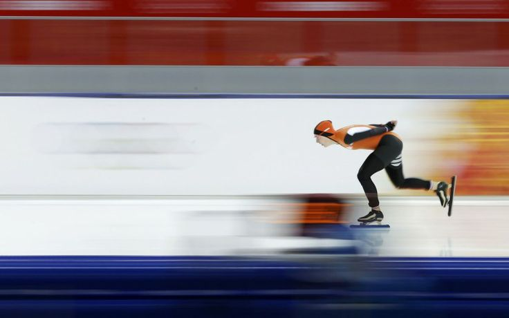 Irene Wust of the Netherlands skates to a first place finish during the women's 3,000-meter speed skating race at the Adler Arena
