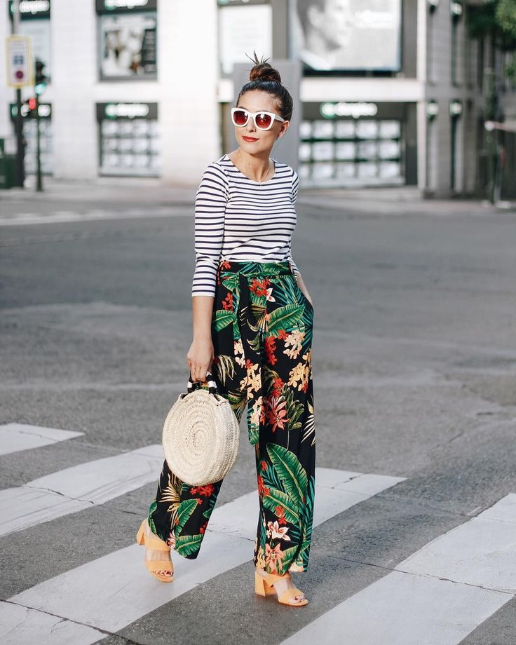 Unusual contrast of stripe t shirt with tropical printed trousers. I don't know if I could pull off this look.
