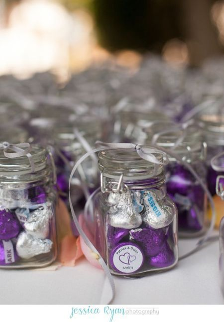 Purple and silver  chocolate kisses favors in an apothecary jar