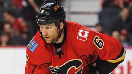 Flames' Dennis Wideman checks ref from behind