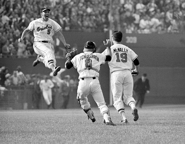 Orioles 3B Brooks Robinson leaps in the air to greet Dave McNally and Andy Etchebarren after the Orioles captured the 1966 World Series. Baltimore is currently leading the AL East and on their way to finishing the season with a winning record for the first time since 1997. (AP)  GALLERY: Classic Photos of the Baltimore Orioles