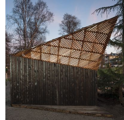 charred cedar shed at a community garden in vancouver bc designed and built by ubc architecture students the unique form prevents shadows from being cast
