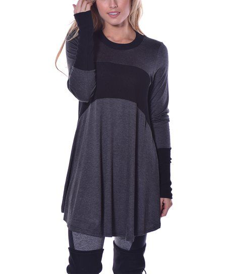 Build a chic ensemble around this flowing tunic featuring on-trend detailing and easy-match solid hues. Size L.