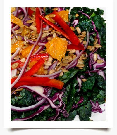 Kale Rainbow Salad Heathy Salad Recipe.  The colorful salad not only tastes good, but it is also filled with phytonutrients and hosts an array of health benefits.