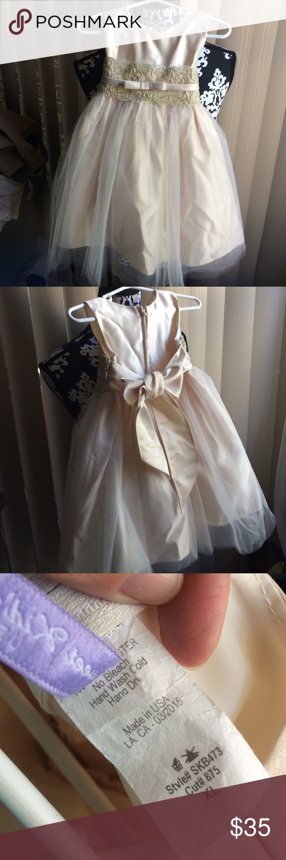 Beautiful satin and tulle special occasion dress Pictures don't do this dress justice. EUC worn once in a wedding. No visible flaws just needs to be steamed! Size is a baby's XL...fit my 24 lb 3 year-old perfectly. Color is champagne. Dresses Formal