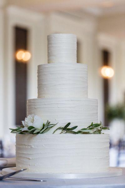 Rustic iced cake: http://www.stylemepretty.com/little-black-book-blog/2015/07/24/elegant-organic-chicago-history-museum-wedding/   Photography: Ann & Kam - http://www.annkam.com/  #wedding #cake #cupcake #caketopper
