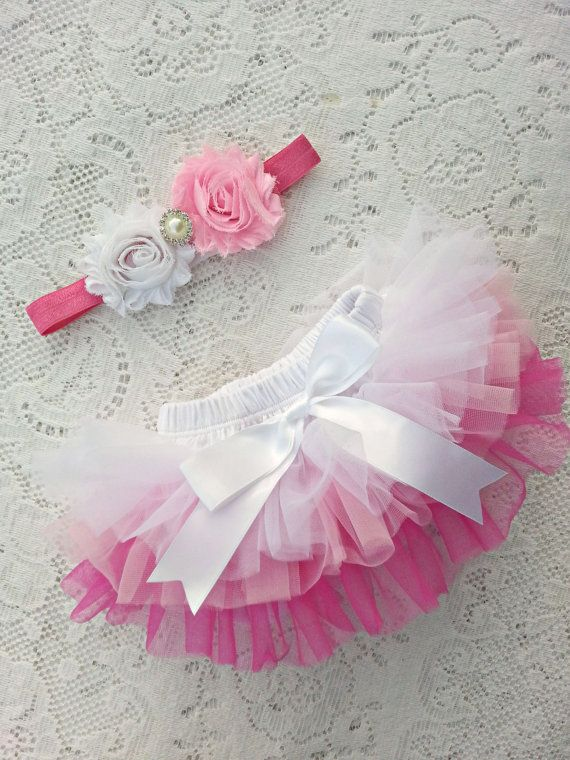 Gorgeous 2 piece Baby Bloomers, Tutu, Pettiskirt, Diaper cover for Your little Princess!  This set includes:  One Delicate solid chiffon Ombre Ruffle bloomer/diaper cover. Ruffles are all around the bloomer, Front and Back.   One beautiful matching flower rhinestone, pearls headband and soft stretchy 5/8 elastic  Condition: New Color: White, pink, hot pink Materials: chiffon, cotton, satin, spandex Size: XSmall: 0-3 months (12-14 waist) Small: 3-18 months (14.5-19 waist)   (Before ordering…
