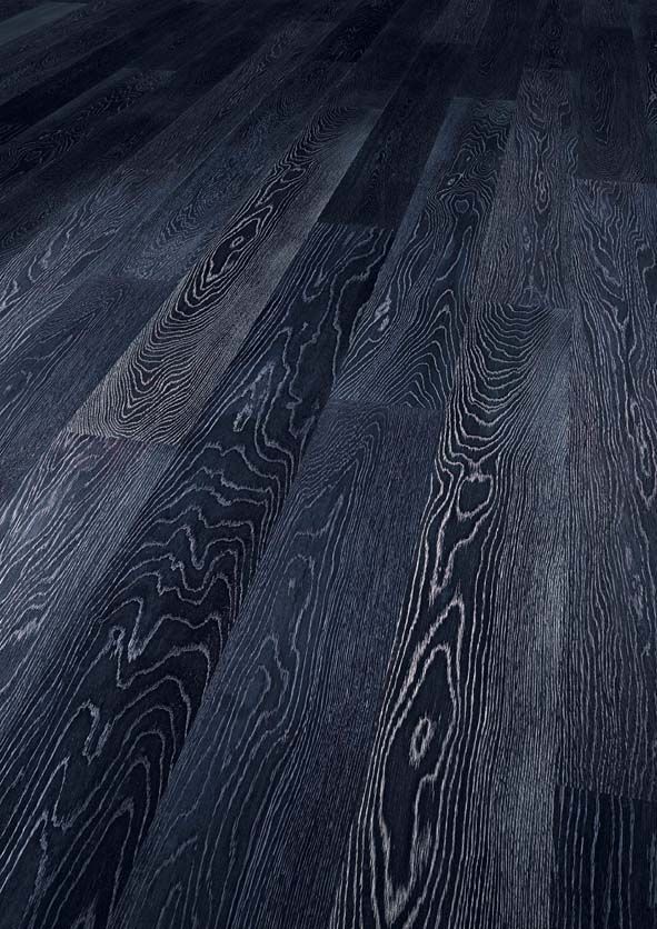 Black stained hardwood flooring, but it's NOT glossy and the grain is left grey.