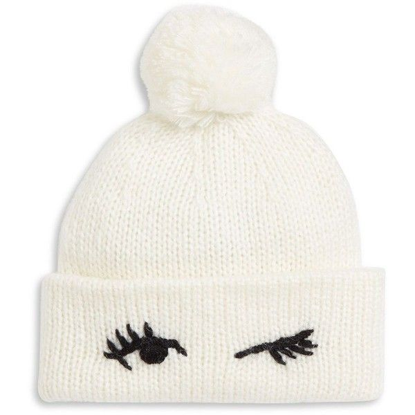 Kate Spade New York Broome Street Wink Beanie (£47) ❤ liked on Polyvore featuring accessories, hats, cream, beanie cap, beanie cap hat, pom beanie, stitch hat and cream beanie