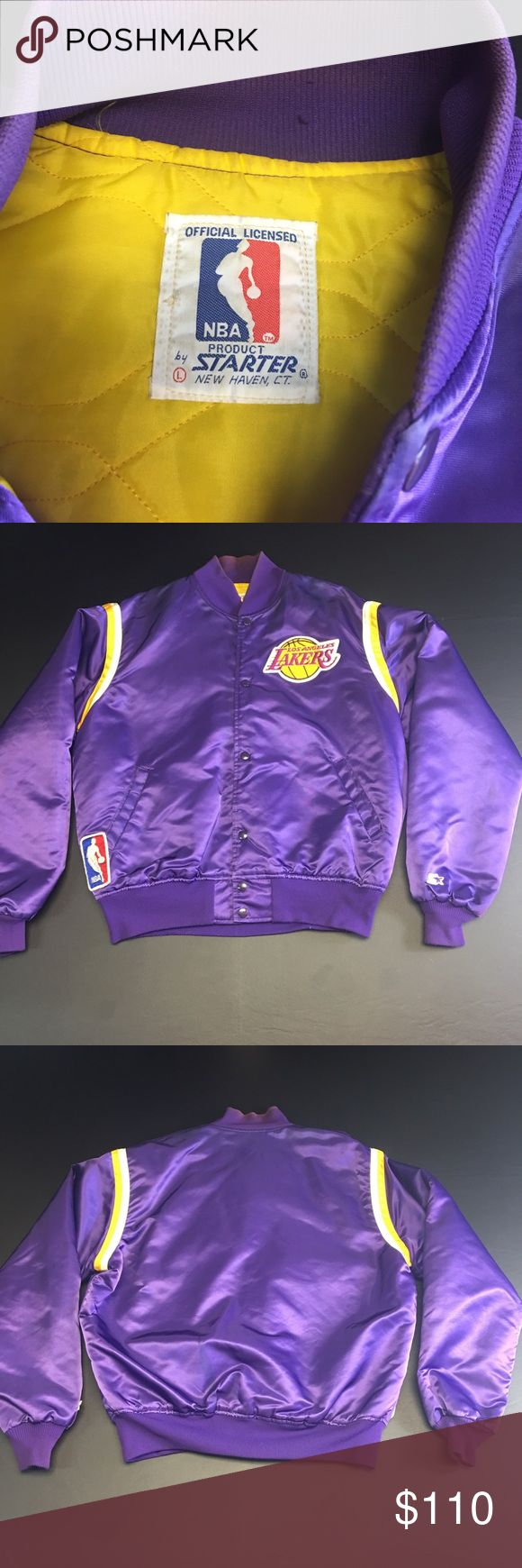 Vintage Los Angeles Lakers Satin Starter Jacket Vintage Men's Large Purple Los Angeles Lakers Satin Starter Jacket. Jacket is preowned and in good condition with one minor flaw. The collar shows signs of discoloration and fading. These style jackets run a size smaller than actual size. Fits like a Men's Medium. Traded a flawless jacket for this. My loss is your gain. Price is reflected by flaw. Starter Jackets & Coats Bomber & Varsity