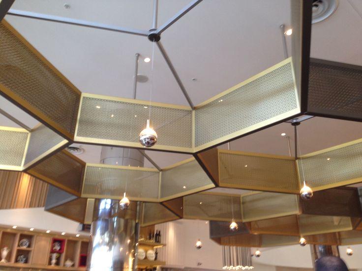 Laser cut Metal light features in Café Baci.