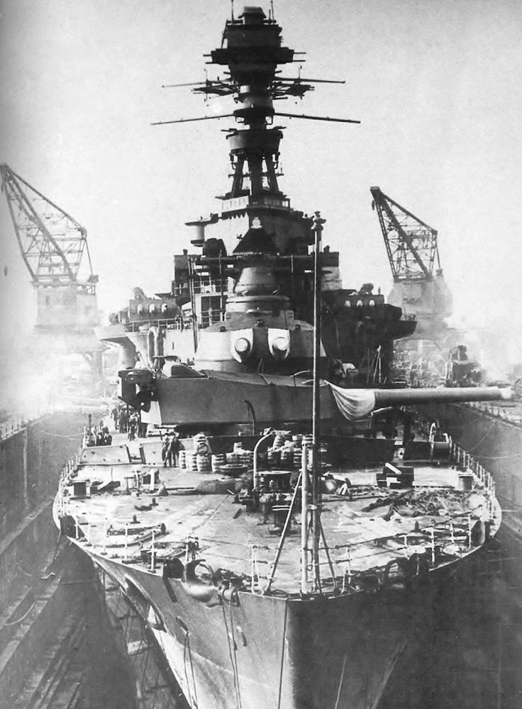 15 battlecruiser HMS Repulse in dry dock between the wars: together with her considerably modernised sister Renown (she never received the same treatment), she and the larger HMS Hood were the only 3 British battlecruisers remaining in service by WW2.  She was famously sunk by Japanese aircraft on 10 December 1941.