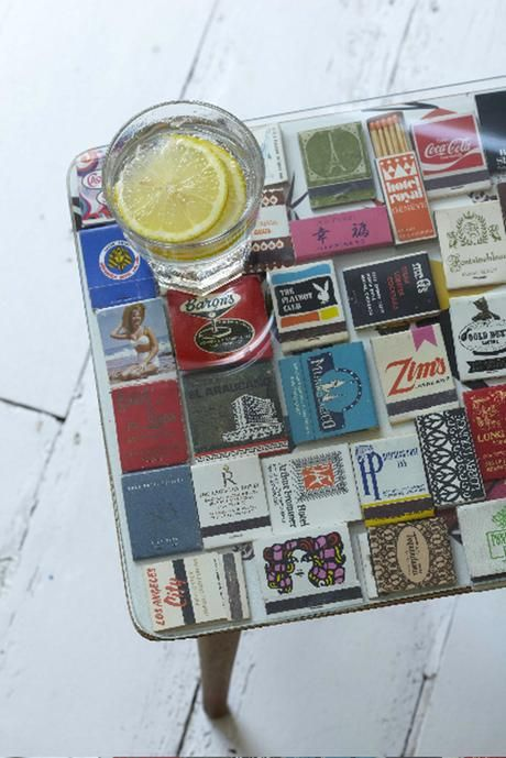 Great table idea, conversation starter, and way to store all those cool/interesting matchbook covers you've collected from your travels over the years ~ Epi.  From lifestyle | tara sloggett