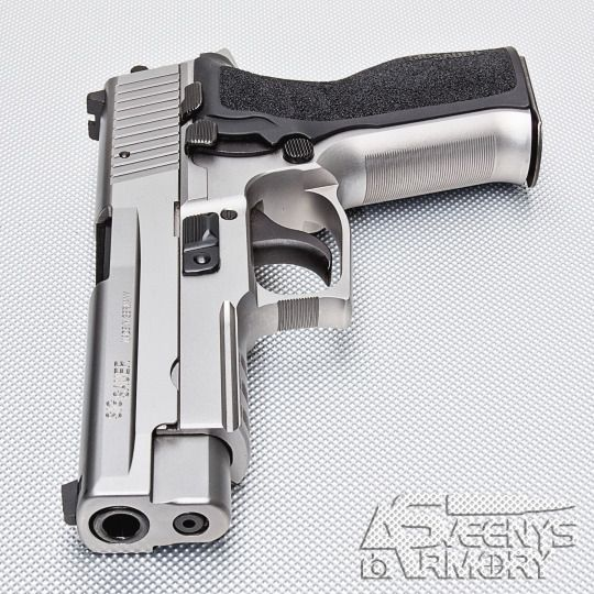 SIG Sauer P226 Stainless  Loading that magazine is a pain! Get your Magazine speedloader today! http://www.amazon.com/shops/raeind