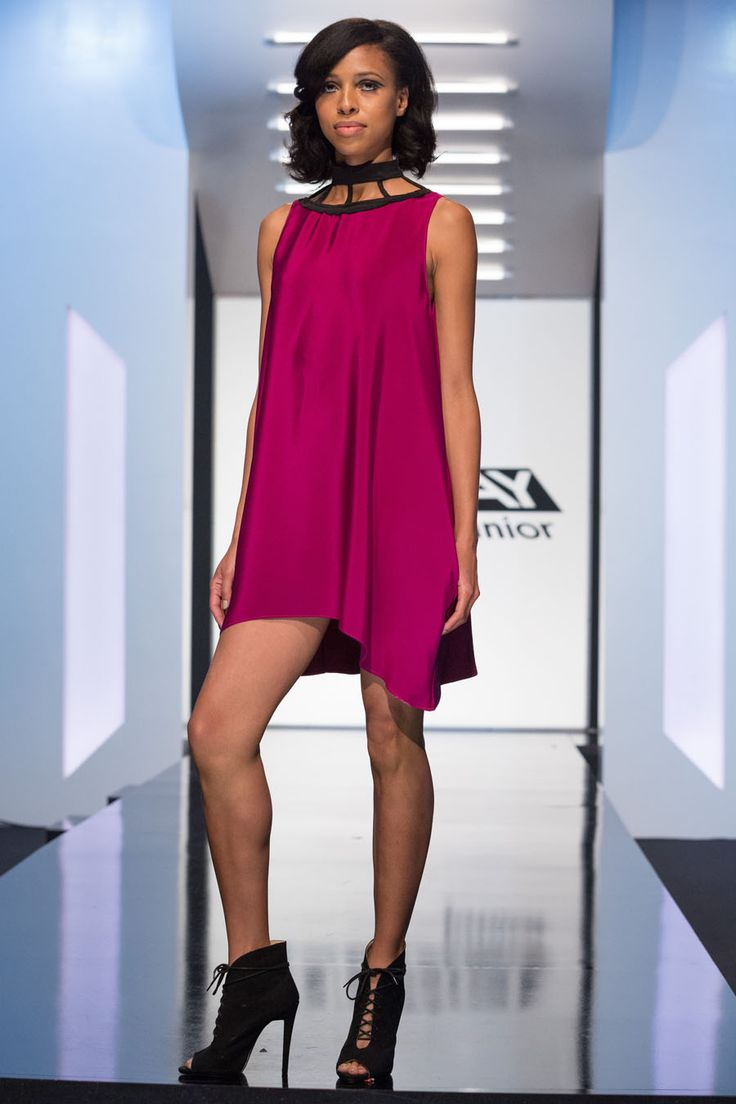 Maya look from episode 3 of Project Runway Junior Season 1.Purple sleeveless swing dress with black trim collar detail.- Designer MayaAccessories do not come with the clothing.