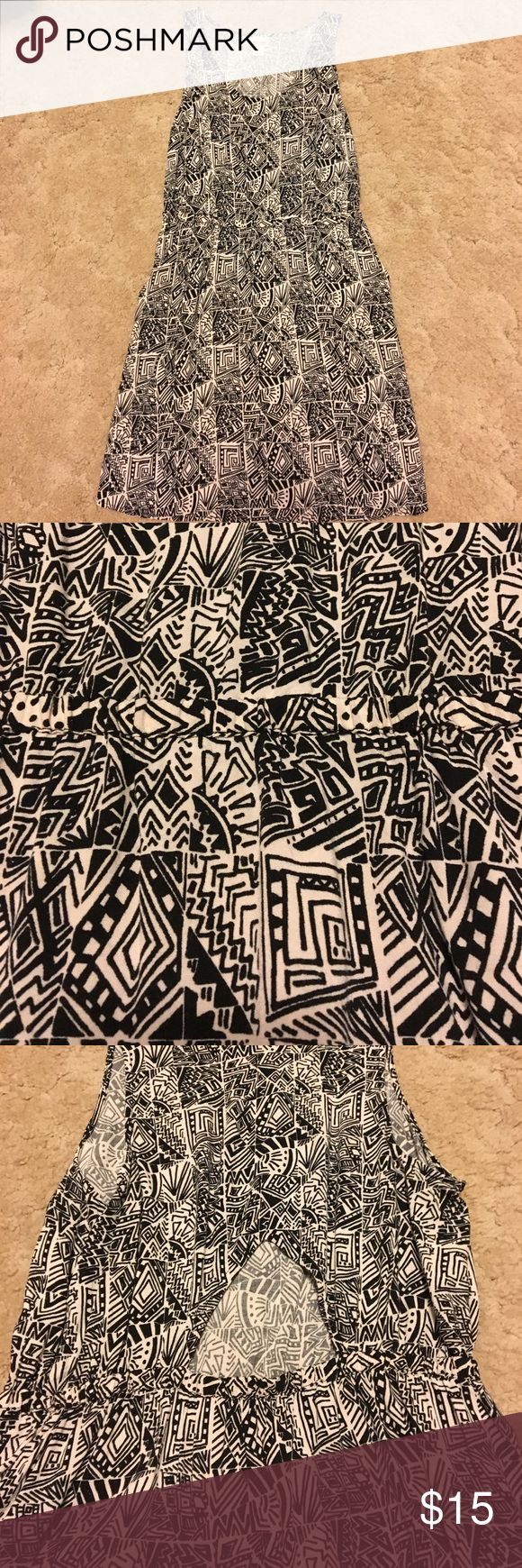 Black and white tribal print dress Awesome tribal print dress from Target! This dress has pockets and a cute triangular cut-out in the back! Perfect for summer concerts! Mossimo Supply Co. Dresses