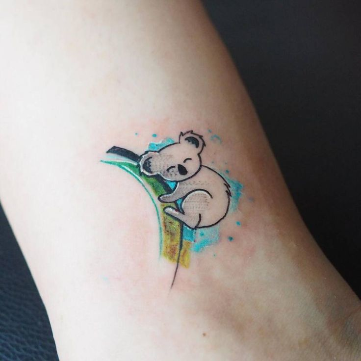 Koala tattoo on the left bicep.